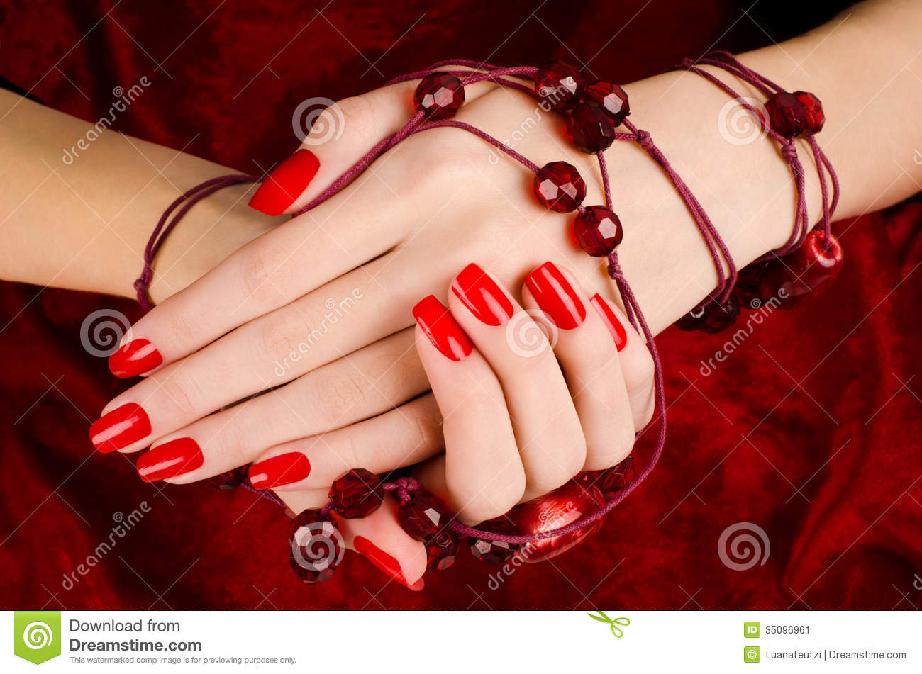 close-up-beautiful-female-hands-sexy-red-manicure-woman-velvet-background-35096961.jpg
