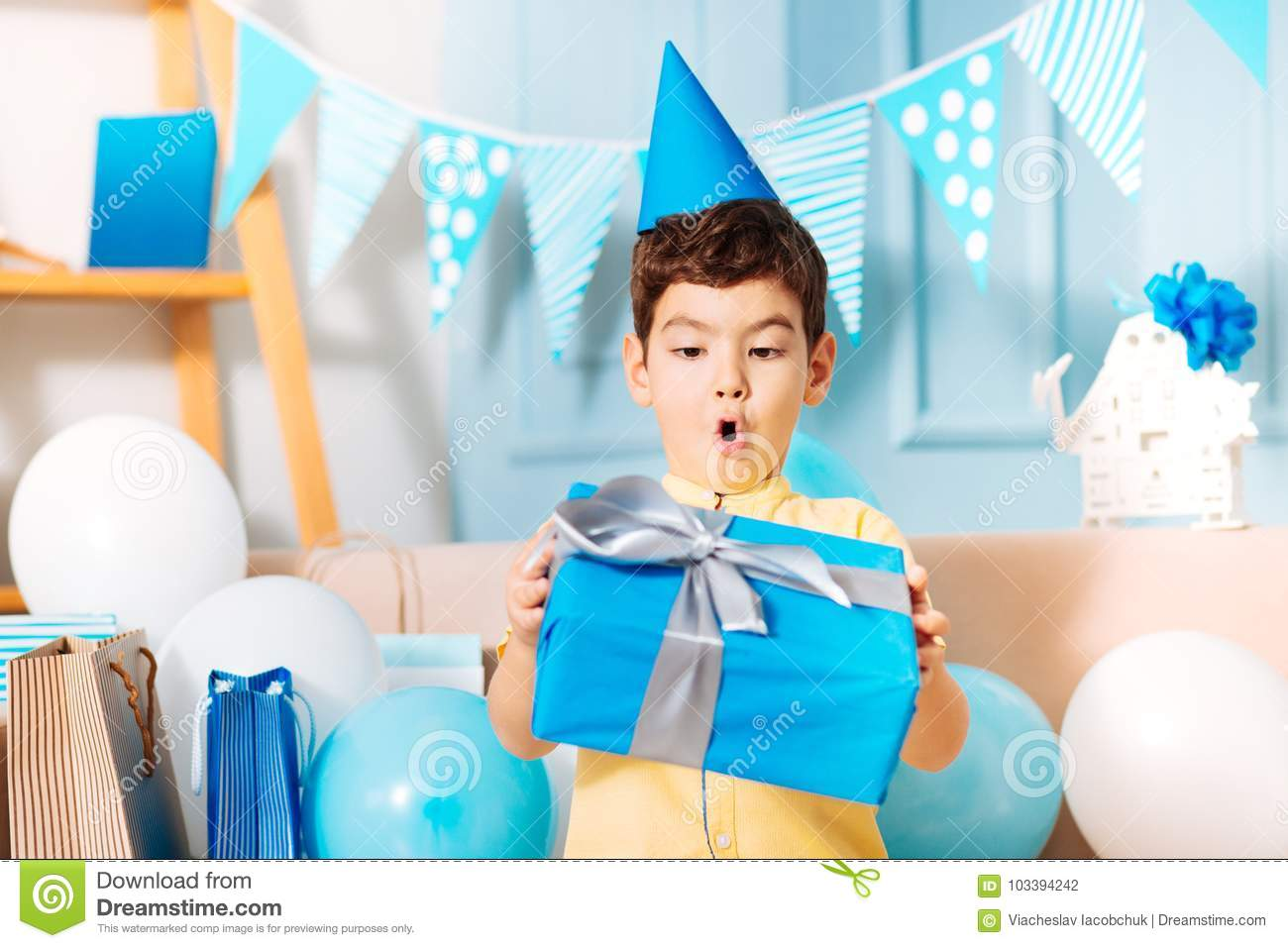 little-boy-looking-his-birthday-gift-surprise-incredible-adorable-holding-blue-box-present-sur...jpg